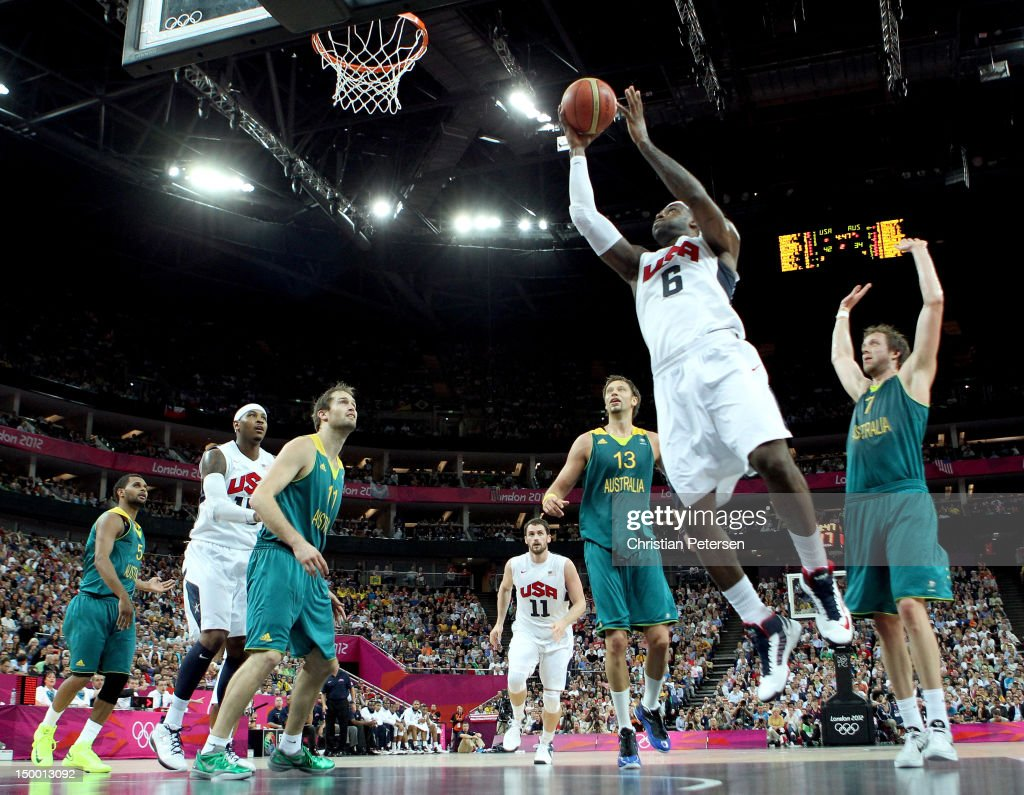 LeBron James #6 of United States goes up for a shot between David Andersen #13 and Joe Ingles #7 of Australia in the first half during the Men's Basketball quaterfinal game on Day 12 of the London 2012 Olympic Games at North Greenwich Arena on August 8, 2012 in London, England.