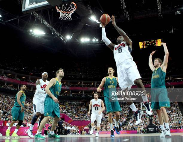 LeBron James of United States goes up for a shot between David Andersen and Joe Ingles of Australia in the first half during the Men's Basketball...
