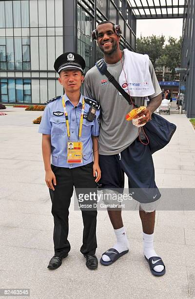 LeBron James of US Men's Senior National Team poses with a security guard during the 2008 Beijing Summer Olympics on August 19 2008 at the USOC...