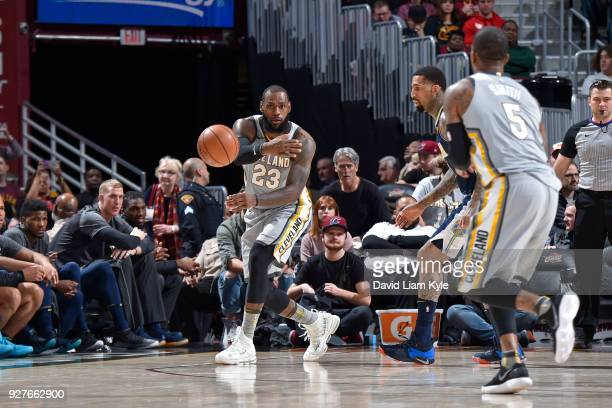 LeBron James passes the ball to JR Smith of the Cleveland Cavaliers during the game against the Denver Nuggets on March 3 2018 at Quicken Loans Arena...