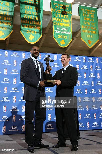 LeBron James receives the 2008-2009 MVP trophy from Kia Motors America's Tim Chaney on May 4, 2009 at St. Vincent-St. Mary's High School in Akron,...