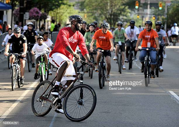 LeBron James riding a bike through the streets of Akron during his 'King for Kids Bikeathon' on August 7 in Akron Ohio NOTE TO USER User expressly...