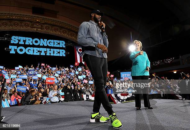LeBron James speaks as Democratic presidential nominee former Secretary of State Hillary Clinton looks on during a campaign rally at the Cleveland...