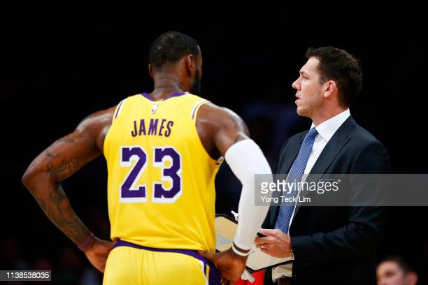 LeBron James speaks with Los Angeles Lakers head coach Luke Walton during the second half of the game against the Washington Wizards at Staples...