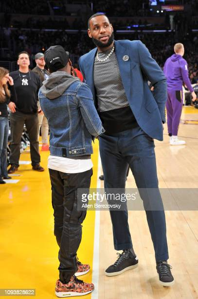 LeBron James talks to his agent Rich Paul during halftime of a basketball game between the Los Angeles Lakers and the Cleveland Cavaliers at Staples...