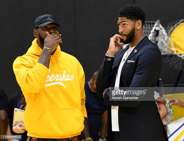 LeBron James talks with Anthony Davis after a press conference where Davis was introduced as the newest player of the Los Angeles Lakers at UCLA...