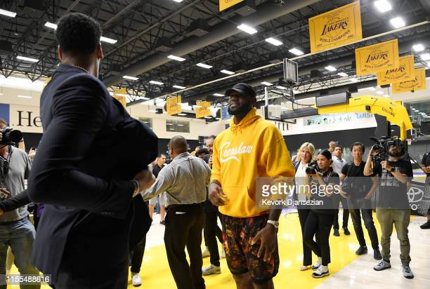 LeBron James talks with Anthony Davis after during a press conference where Davis was introduced as the newest player of the Los Angeles Lakers at...