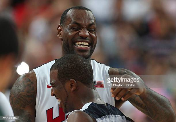 Lebron James, USA, celebrates victory with team mate Chris Paul during the Men's Basketball Final between USA and Spain at the North Greenwich Arena...