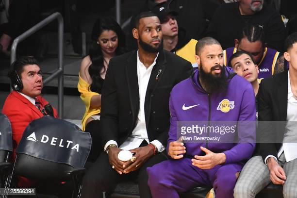 LeBron James watches from the bench during a basketball game between the Los Angeles Lakers and the Phoenix Suns at Staples Center on January 27 2019...