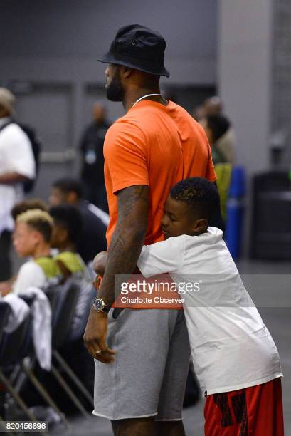 LeBron James watches his son LeBron Jr's team during youth tournament action at the Charlotte Convention Center in Charlotte NC on Friday July 21 as...
