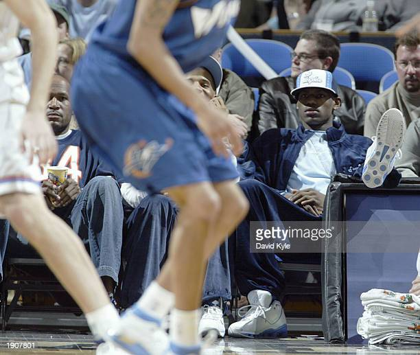 LeBron James watches Michael Jordan of the Washington Wizards play the Cleveland Cavaliers at Gund Arena April 8 2003 in Cleveland Ohio NOTE TO USER...