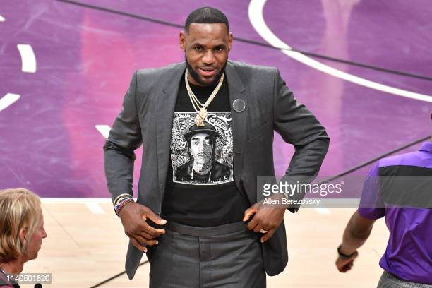 LeBron James wears a shirt as a tribute to Nipsey Hussle during a basketball game between the Los Angeles Lakers and the Golden State Warriors at...