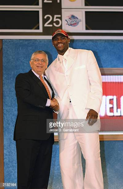 LeBron James who was selected by the Cleveland Cavaliers shakes hands with NBA Commissioner David Stern during the 2003 NBA Draft at the Paramount...