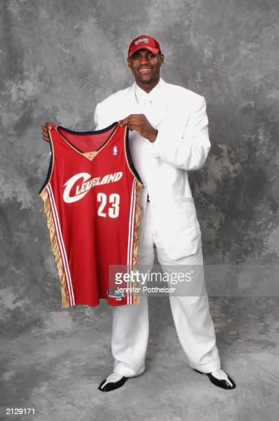 LeBron James who was selected first overall by the Cleveland Cavaliers poses for a portrait during the 2003 NBA Draft at the Paramount Theatre at...
