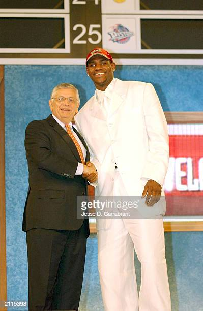 LeBron James who was selected number one overall in the first round by the Cleveland Cavailiers shakes hands with NBA Commissioner David Stern during...