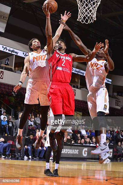 LeBryan Nash of the Rio Grande Valley Vipers shoots against Michael Bryson and Derek Cooke Jr #11 of the Northern Arizona Suns on December 9 at...