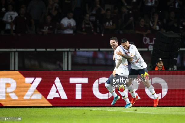 Lecce forward Diego Farias and Lecce forward Gianluca Lapadula celebrates after scoring their second goal to make it 12 during the Serie A football...