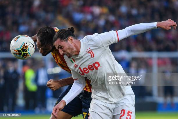 Lecce's Greek midfielder Panagiotis Tachtsidis and Juventus' French midfielder Adrien Rabiot go for a header during the Italian Serie A footbal match...