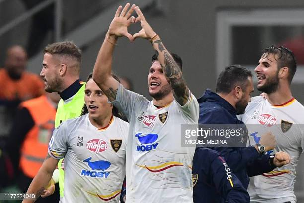 Lecce's Italian defender Marco Calderoni celebrates after scoring an equalizer during the Italian Serie A football match AC Milan vs Lecce on October...