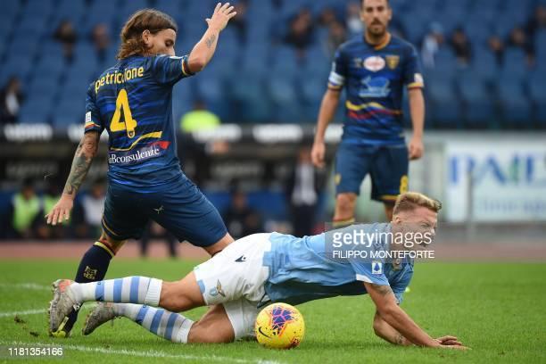 Lecce's Italian midfielder Jacopo Petriccione tackles Lazio's Italian forward Ciro Immobile during the Italian Serie A football match Lazio Rome vs...
