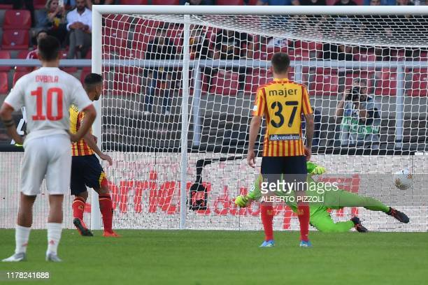 Lecce's Italian midfielder Marco Mancosu shoots to score a penalty and equalize during the Italian Serie A footbal match Lecce vs Juventus on October...