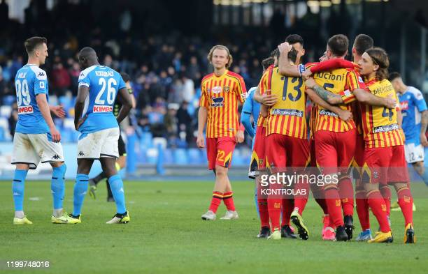 Lecce's players celebrate as Napoli's players react at the end of the Italian Serie A football match SSC Napoli vs US Lecce. Lecce won 3-2.