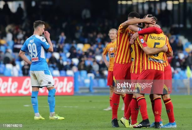 Lecce's players celebrate as Napoli's Polish striker Arkadiusz Milik reacts at the end of the Italian Serie A football match SSC Napoli vs US Lecce....