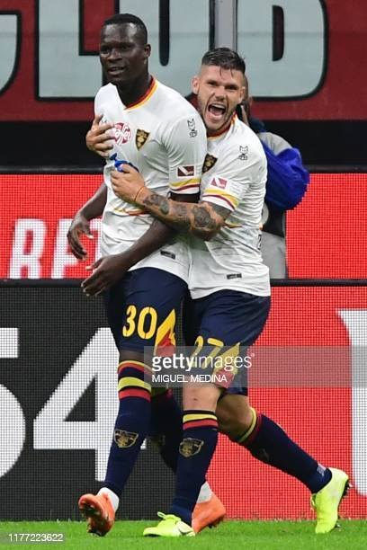 Lecce's Senegalese forward Khouma Babacar celebrates with Lecce's Italian defender Marco Calderoni after scoring a penalty during the Italian Serie A...