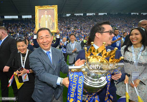 Leceister City owner Vichai Srivaddhanaprabha and son Aiyawatt Srivaddhanaprabha hold the Premier League Trophy after the Barclays Premier League...