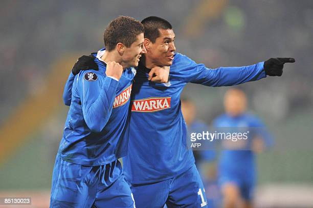 Lech Poznan's forward Hernan Rengifo and Robert Lewandowski celebrate after scoring during their UEFA Cup round of 32 football match against Udinese...