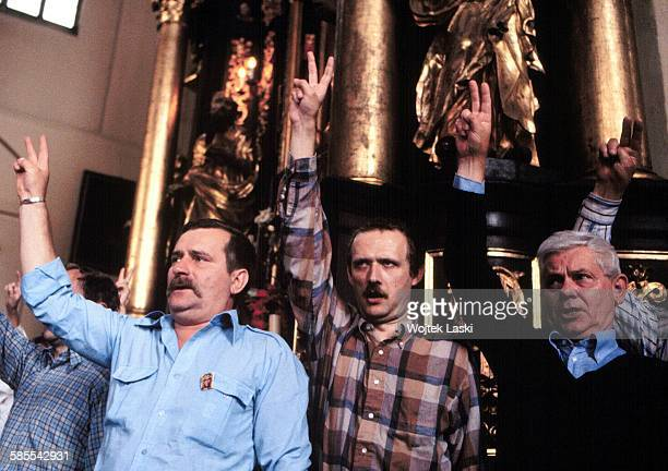 Lech Walesa Adam Michnik and Zbigniew Herbert participate in a holy mass in St Nicholas' Church in September Gdansk Poland