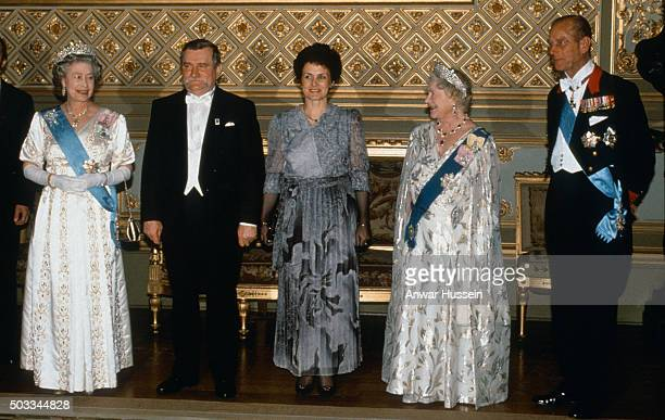 Lech Walesa and his wife Danuta Walesa pose with Queen Elizabeth ll Queen Elizabeth the Queen Mother and Prince Philip Duke of Edinburgh before a...