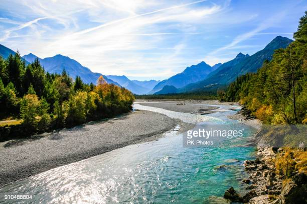 lechriver at autumn, near forchach, lechtaler alps, tirol, austria - austria stock pictures, royalty-free photos & images