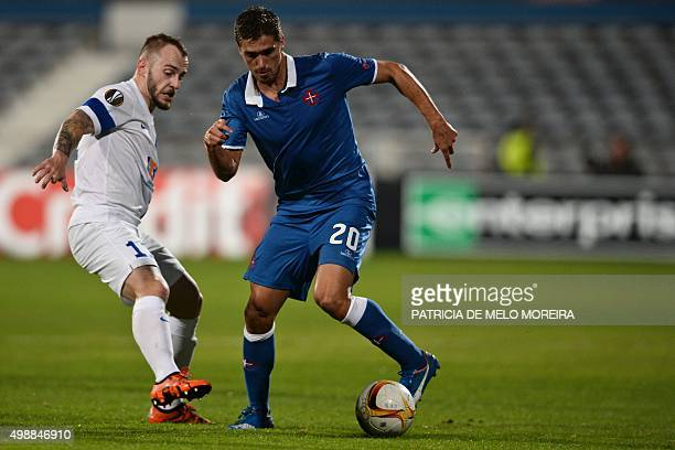 Lech's Hungarian forward Gergo Lovrencsics vies with Belenenses's defender Filipe Ferreira during the UEFA Europa League Group I football match Os...