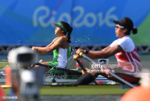 Lechuga Alanis of Mexiko and Saiyidah Mohamed Rafa'ee of the Republic of Singapore compete in the Women's Single Sculls Quarterfinals of the Rowing...