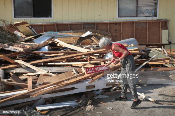 LeClaire Bryan mother of country music artist Luke Bryan places a sign she found on a pile of rubble left by Hurricane Michael near her home on...