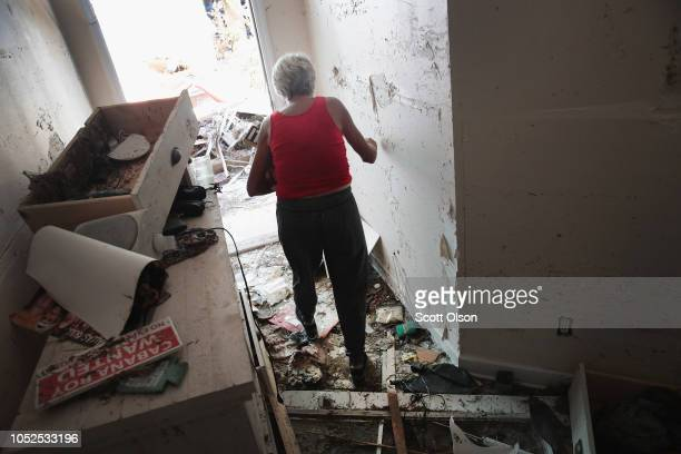 LeClaire Bryan mother of country music artist Luke Bryan walks through her home after it was severely damaged by Hurricane Michael on October 19 2018...