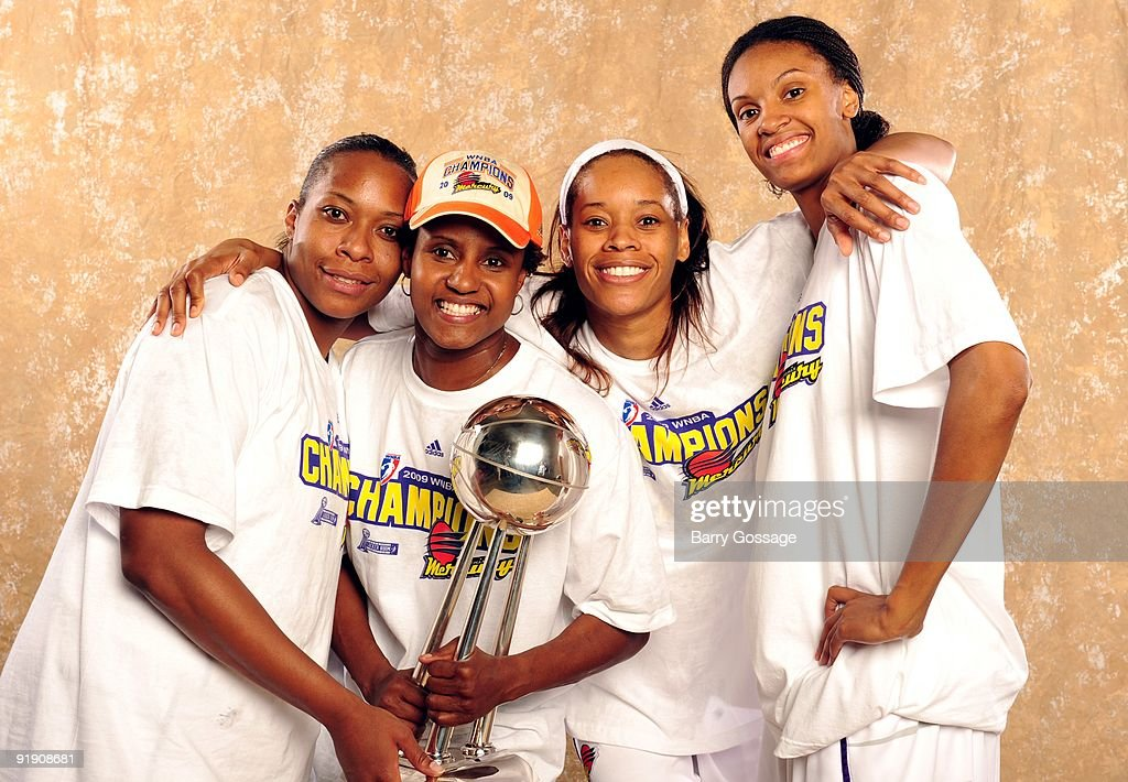 Le'coe Willingham #43, assistant coach Bridget Pettis, Tangela Smith #50 and DeWanna Bonner #24 of the Phoenix Mercury pose with the WNBA Championship Trophy after defeating the Indiana Fever 94-86 in Game Five of the WNBA Finals at U.S. Airways Center on October 9, 2009 in Phoenix, Arizona.