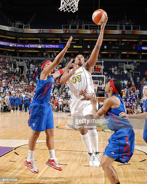 Le'coe Willingham of the Phoenix Mercury shoots against Deanna Nolan of the Detroit Shock on June 14 at US Airways Center in Phoenix Arizona NOTE TO...