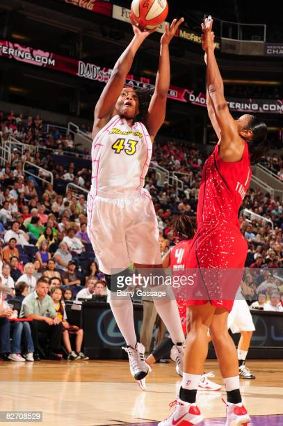 Le'coe Willingham of the Phoenix Mercury shoots against Tina Thompson of the Houston Comets on September 7 at US Airways Center in Phoenix Arizona...