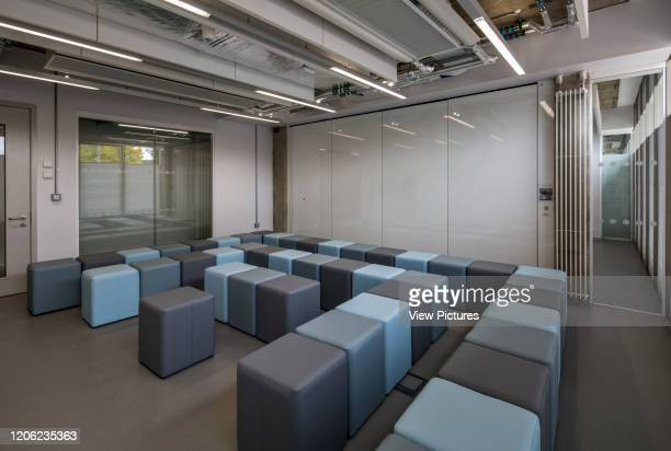 Lecture room with closed partition wall. Wilfred Brown Building at Brunel University, Uxbridge, United Kingdom. Architect: Sheppard Robson, 2017.