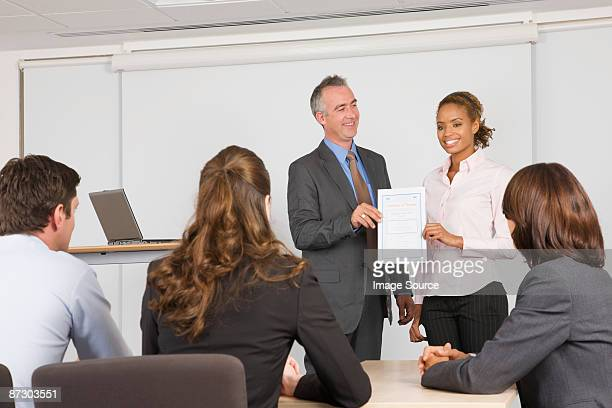 Lecturer handing student a certificate