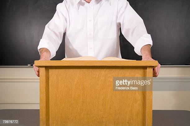 lecturer standing behind lectern - lectern stock pictures, royalty-free photos & images