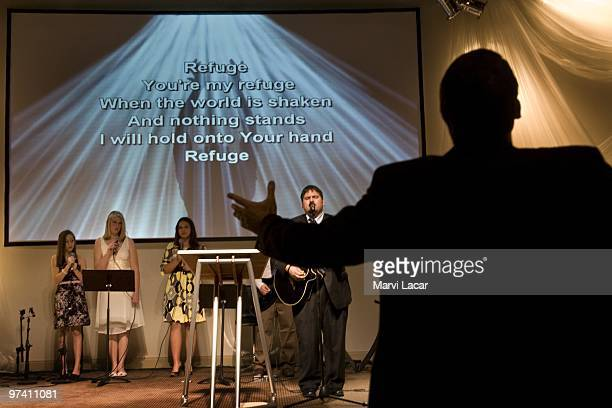 Led by associate pastor JR Hall congregants sing before the sermon during a purity ring ceremony on February 13 2008 at the Full Life Assembly of God...