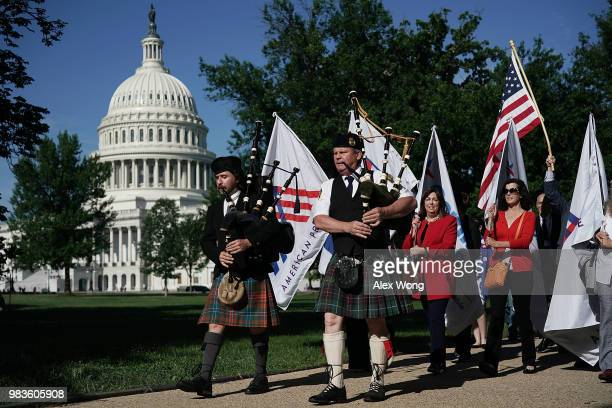 Led by bagpipers Jeff Herbert of Gaithersburg Maryland and Duncan S Moore of Baltimore Maryland activists march to Senate Hart Office Building June...