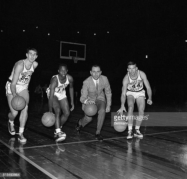 Led by coach Bob Cousy members of the Boston College basketball team practice dribbling during a workout at Madison Square Garden 3/11 in preparation...