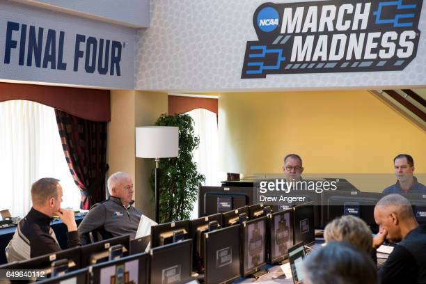 Led by committee chairman Mark Hollis the NCAA Basketball Tournament Selection Committee meets on Wednesday afternoon March 8 2017 in New York City...
