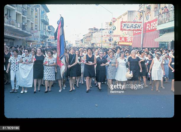 Led by flag carrying Mrs Carlos Arias wife of the assembly president thousands of women supporters of Panama's new president Max Devalle stage a...