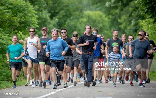 Led by Justin Grunewald, second from left, and reality celebrity Chip Gaines, in blue, family, friends and supporters finished a one-mile run in...