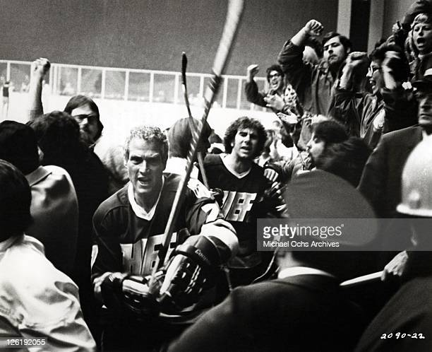 Led by their playercoach Reggie Dunlop and Dave 'the killer' Carlson the Charlestown Chiefs charge into the stands to attack a heckling spectator...